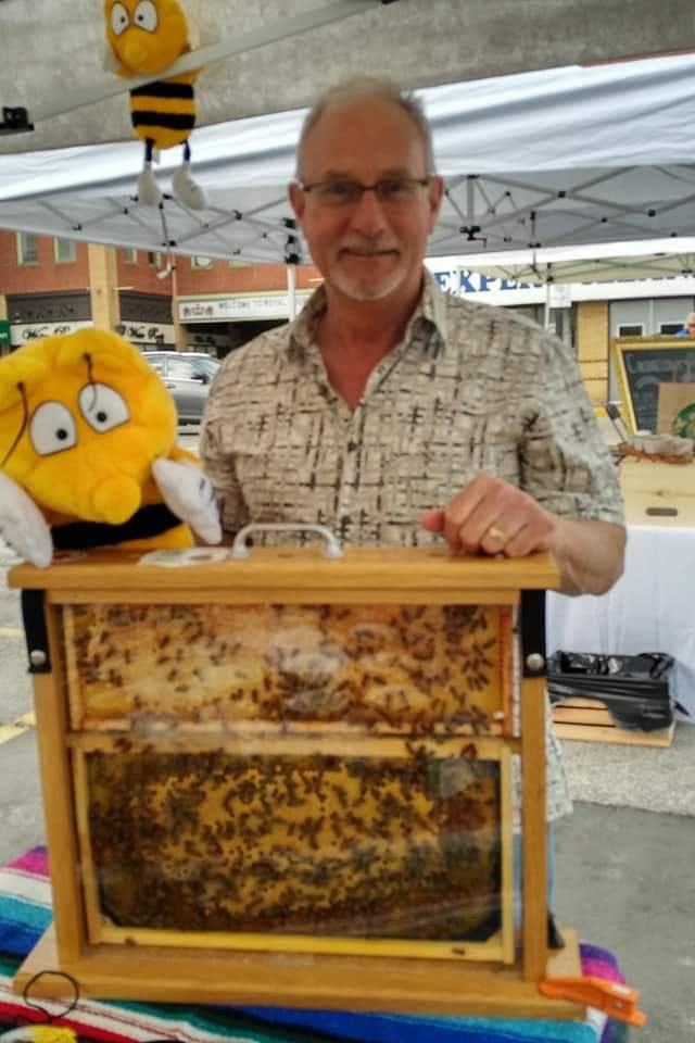 Humbervalley Honey Man Posing with Beehive